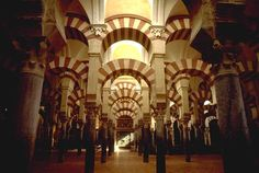 Cordoba, Spain. I love the Islamic influence of the poly chrome and double horseshoe arch