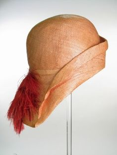 Orange-red woven split straw cloche hat with rayon lining and scarlet ostrich feathers, by Marshall & Snelgrove, English (London), 1928-1930.