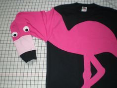 NEW!! New to the Zoo!! Long sleeve t-shirt with a sewn on appliqued flamingo. The sleeve forms the neck and head and is fully interactive!! Clothes should be fun for adults and kids! All of my shirts are designed and made by me from start to finish. All appliques are cut, adhered