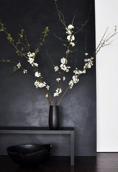 Deep textured black walls with a simple glossy black pot make these minimal flowers stand out (so many adjectives, but this could fit in any living or entry space in your home!)