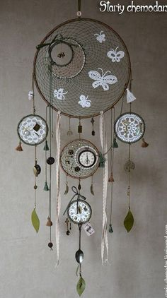 Another intricate but definitely beautiful piece. Create different styles of dream catchers with a common theme and attach them to each others. Don't be afraid to experiment with the design and use clocks or perhaps,spoons.