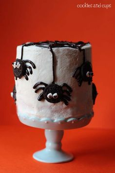 Wonderfully cute spider bedecked Halloween cake. #cake #Halloween #food #baking #cooking #spiders #decorated #kids #party #autumn #fall #cute