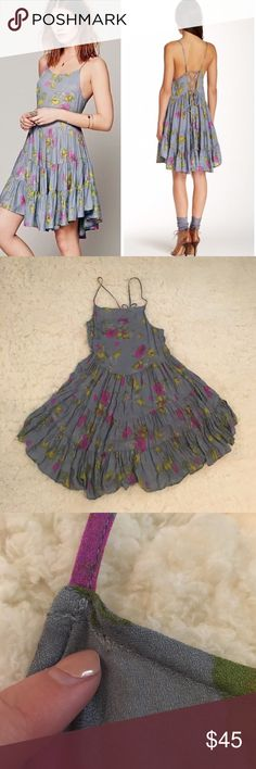 Free People Circle of Flowers Slip A floral print gives this Free People dress a vintage feel, and a tiered skirt effects a flirty, swingy profile. Lace-up detailing in back. Unlined. Teeny tiny hole noted but you it is very hardly noticeable Free People Dresses
