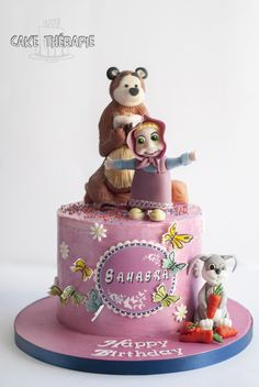 Masha and the bear cake. Finished in Buttercream and decorated with fondant figures. No moulds used.