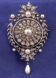 Antique Diamond Pendant/Brooch, set with old mine and rose-cut diamonds, white pearl accents, silver-topped 18kt gold mount, with detachable pendant hook, French guarantee and import stamps, lg. 2 3/4 in. Edwardian or Edwardian style.