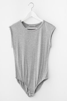 Basic jersey knit rolled up cap sleeve bodysuit. Looks amazing paired with…
