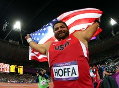 Reese Hoffa of the United States celebrates his bronze medal in the Men's Shot Put Final on Day 7 of the London 2012 Olympic Games at Olympic Stadium on August 3, 2012 in London, England.