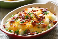 Loaded Cauliflower Mash Bake - - Creamy mashed cauliflower made with a touch of whipped butter, buttermilk, garlic and herbs and topped with cheese and bacon – low-carb, but you'll swear it's loaded with tons of calories! Ww Recipes, Skinny Recipes, Cooking Recipes, Healthy Recipes, Skinnytaste Recipes, Bacon Recipes, Loaded Mashed Potatoes, Baked Potatoes, Loaded Cauliflower