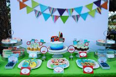 surf's up third birthday party surfing dessert table