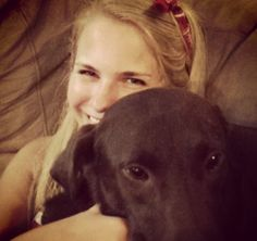 Our PR director Sara Grace getting some love from her rescued lab, Dutch!