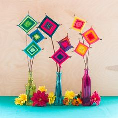 DIY: God's Eye Bouquets - learn to make a variation of a God's Eye with a long stem to display in colorful vases.