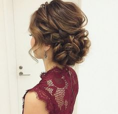 I love the elegance and whimsical elements of this updo