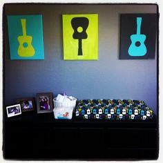 Groovy Guitars baby boy room. we would have to incorporate drums too, of course.