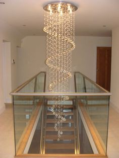 The Standard Spiral Chandelier has a plate and a drop. As with all of our products, other sizes & designs can be made on request. Simplycontact us with your required width or lengt… High Ceiling Lighting, Stairway Lighting, Ceiling Light Design, Ceiling Lights, Modern Chandelier, Chandeliers, Chandelier Lighting, Wooden Staircase Railing, Staircase Design