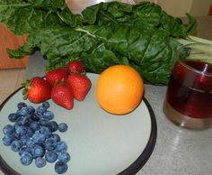 Swiss Chard Smoothie...added cranberry pomegranate juice, blueberries, strawberries, orange, and ice.  The kids love it!