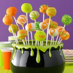 Halloween Cheesecake Pops - 3 pkgs (8 oz each) cream cheese, softened, 1 cup sugar, 1 cup (8 ounces) sour cream, 1 tsp. vanilla, 3 eggs, beaten,1 cup graham cracker crumbs,1 pkg, (12 oz) each orange, vibrant green, white Wilton candy melts and variety of toppings.