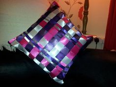 Woven ribbon cushion.