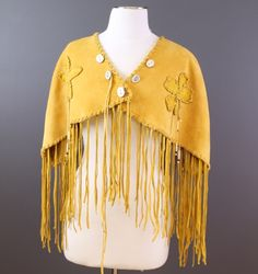 Hide Shawl by Holly Joseph, Lil'wat Nation; Hand made from deer hide with antler buttons and bone and glass bead details.This piece has been sold, please considar commissioning a similar piece by the artist; Contact us for more details.