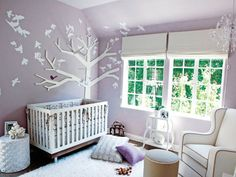 Another great room using soft lavender wall color. Room designed for celeb Tiffany Theissen (who later went on to collab on a baby decor line with the designer Lonni Paul). The tree is a pretty cool effect, and I love the chair!  The rug looks oh so shaggy and soft too!