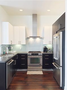 White, grey, black, silver, mint, wooden floors.. Perfect kitchen.