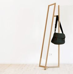 Club (A freestanding full-length mirror / wardrobe combination. Made for the German manufacturer Schönbuch, the piece appears to be a mirror at first glance. Peep behind it and you'll discover that the attached stand also doubles as a hidden place to hang your clothes or coat, as well as your hat.