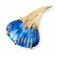 Lapis Brooch, 2006 - A Lapis carved in the form of a shell set in Yellow Gold textured wire with Cognac Diamonds
