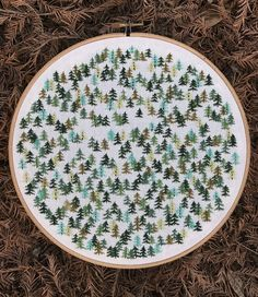 http://sosuperawesome.com/post/158283323460/embroidery-hoop-wall-hangings-by-forest-fibers