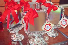 Absolutely love these full-size vanity mirrors as favors to a Snow White party. In general, I'm in favor of one meaningful favor over a bag of junk any day.