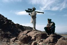 An Afghan mujahideen aims a FIM-92 Stinger missile at passing Soviet aircraft, 1988