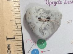 Lake Michigan natural heart beach stones are fun to look for but even more fun to make buttons out of them.  Perfect natural item. by UpcycleDesignsByDana on Etsy