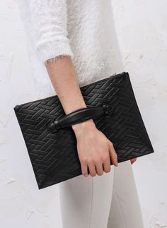 Black textured leather clutch bag, chic style