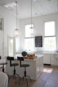 Bright and white w/ lots of natural light. An arts room like this would be awesome. I like the tall ceilings, giant windows