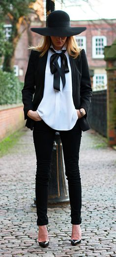 White shirt, black bow, black skinnies, black hat, black stilettos!