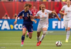 Rumi Utsugi #13 of Japan tries to chase down Lieke Martens #11 of the Netherlands during the FIFA Women's World Cup Canada 2015 Round of 16 match between the Netherlands and Japan June, 23, 2015 at BC Place Stadium in Vancouver, British Columbia, Canada.