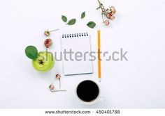 Cup of black coffee, sketchbook with pencil and dry rose flowers. Flat lay, top view
