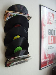 Magazine rack made from old vinyl records.  Baked in the oven at 225 degrees and molded to hold magazines.  Cute idea for a music room.