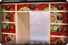 This desk has fabric decoupaged onto the drawers. AWESOME idea. This is happening in my life.
