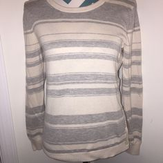 Banana Republic Sweater Super soft cream and grey stripped sweater from Banana Republic. Long sleeves and cute button design along one side. No flaws! Banana Republic Sweaters