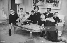 Future Atty. Gen.. Robert Kennedy holding baby Michael while posing w. wife Ethel & children (L-R) Bobby Jr. ,4, Kathleen, 6, Courtney, 1, David, 2, & Joe, 5, w. their dog, at home just before leaving for the christening of their new baby boy.