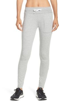 A close, legging-like fit flatters these sporty lounge pants designed with generous slip pockets.