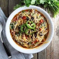 Smoky Chicken Chili. No smoker required!! This brilliant oven-smoked chicken method is unbelievable! Pulled chicken chili with beans, tomatoes, peppers, garlic, onions and stock. Full of healthy yumminess, this is the perfect winter soup. http://tasteandsee.com