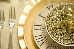 I love this one!  3 different plates.. Gold theme last plate is Roman Numerals.. A bowl on top filled.. Just for fun with beeds! You probably still have these around from the Christmas!  A shimmer table cloth  Beautiful!, *