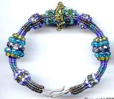 This colorful tubular Ndebele/herringbone bracelet has several increasing/decreasing methods that look like beaded beads - but its all one piece! The