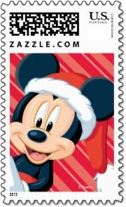 Mickey Mouse looks out on this Disney Christmas stamp wearing a Santa hat.