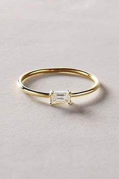 love the simplicity of this ring! Baguette Diamond Ring in 14k Yellow Gold - anthropologie.com