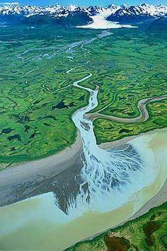 Aerial photo of Copper River Delta, Sheridan Glacier and Chugach Mountains in distance.  Near Cordova, Alaska, AK  United States