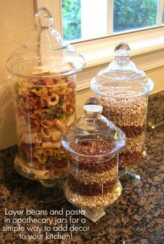 Apothecary jars filled with beans and pasta or popcorn make great (and inexpensive) decor for a kitchen!