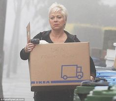 Denise Welch was pictured on Friday moving out of the house she shares with fiancé Lincoln Townley