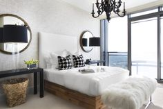 Wall Treatment - A pair of mirrors and a glossy black chandelier decorating a bedroom