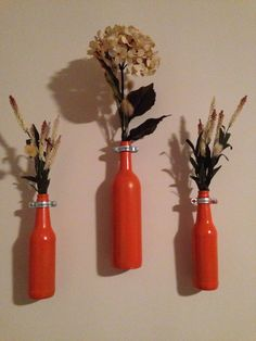 minus the flowers Spray painted wine bottles  #diy #orange #winebottle